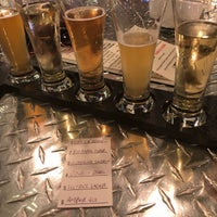 Photo taken at Mad Beach Craft Brewing Company by Eric R. on 12/27/2017