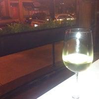 Photo taken at Aquitaine Restaurant by Kim R. on 10/6/2013