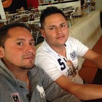Photo taken at Los Pollitos Titan by Ricardo R. on 1/2/2014