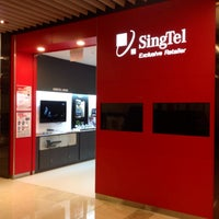 Photo taken at Singtel shop by gerard t. on 9/21/2013