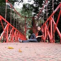 Photo taken at Jembatan Merah Kebun Raya Bogor by Jihan P. on 5/17/2015