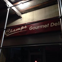 Photo taken at Champs Gourmet Deli by Jeremy H. on 8/31/2013
