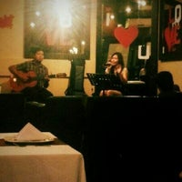 Photo taken at Backyard Grille Restaurant and Cafè by Adrian S. on 2/8/2013
