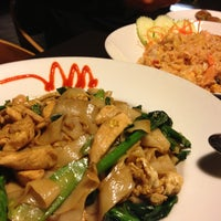 Photo taken at Osha Thai Noodle Cafe by Mango C. on 5/5/2013