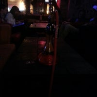 Photo taken at Eastown Hookah Lounge by Neal M. on 1/5/2013
