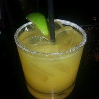 Photo taken at Osha Thai Restaurant & Bar by Regina W. on 12/8/2012