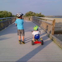 Photo taken at Silver Sands State Park Boardwalk by Maya B. on 7/7/2014