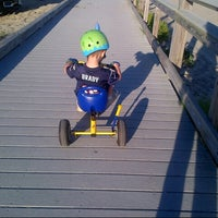 Photo taken at Silver Sands State Park Boardwalk by Maya B. on 9/7/2014