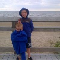 Photo taken at Silver Sands State Park Boardwalk by Maya B. on 8/22/2014