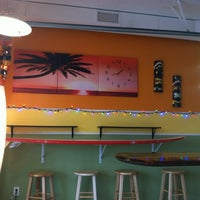 Photo taken at Longboards by Kelly H. on 12/1/2012