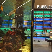 Photo taken at Bubbles Seafood & Wine Bar by Lu B. on 12/17/2012