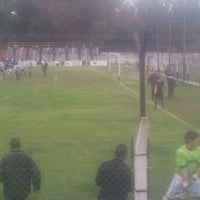 Photo taken at Estadio de Futbol LA EMILIA by Nico B. on 10/7/2012