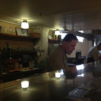 Photo taken at Elliott Bay Café by Philip T. on 3/23/2013