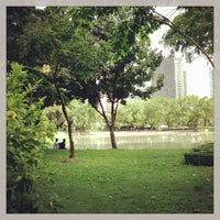 Photo taken at Benchasiri Park by Ace Thanaboon S. on 6/16/2013