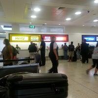Photo taken at Hertz Desk, International Terminal by Elvi S B. on 10/15/2012