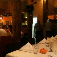 Photo taken at Trattoria Dopo Teatro by Fabio J. on 10/19/2012