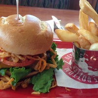 Photo taken at Red Robin Gourmet Burgers by Sam C. on 6/27/2013