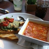 Photo taken at Nourish Cafe by Liza N. on 10/24/2013