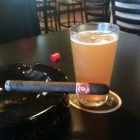Photo taken at Elite Cigar Cafe by Steve K. on 12/16/2012