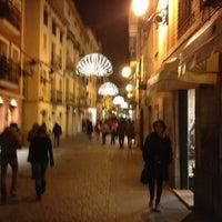 Photo taken at Calle Mayor by Fernando E. on 1/3/2013