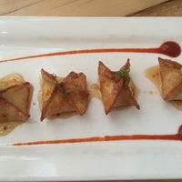 Photo taken at Mini Mango Thai bistro (New name: Mango on main) by Shan S. on 10/17/2014