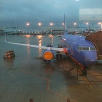 Photo taken at Concourse B by Brian C. on 12/16/2012