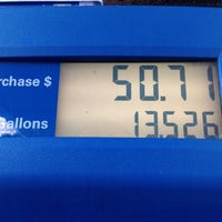 Photo taken at Mobil by Pablo A. on 5/26/2014