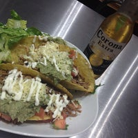 Photo taken at Tuzo Mexican Kitchen by Colin B. on 7/12/2013