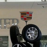 Photo taken at Lund Cadillac Hummer Saab by Riley Kaua K. on 12/6/2012