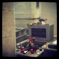 Photo taken at Tombe de Jim Morrison by Ivan R. on 1/26/2013