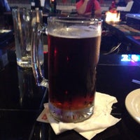 Photo taken at Salty Dog Sports Bar and Grill by balex h. on 12/27/2014