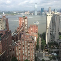 Photo taken at New York Marriott Downtown by Aaron W. on 6/28/2013
