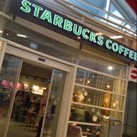 Photo taken at Starbucks by Akira G. on 12/27/2012