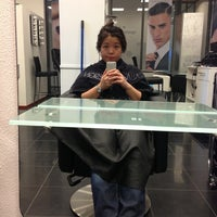 Photo taken at Shaquille's Hair & Beauty Plaza by Vivien W. on 6/21/2013