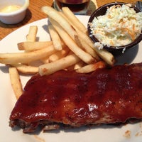 Photo taken at Outback Steakhouse by Tiger W. on 7/5/2013