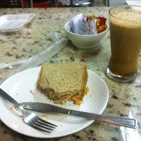 Photo taken at Delícia Café by Talita G. on 10/9/2012