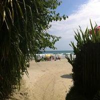 Photo taken at Praia da Baleia by Flávia C. on 12/31/2012
