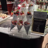 Photo taken at Godiva Chocolatier by A on 11/28/2013