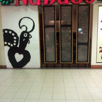 Photo taken at Nando's by Eha Isabella on 12/19/2012