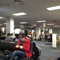 Photo taken at Concourse C by Topher on 12/22/2012