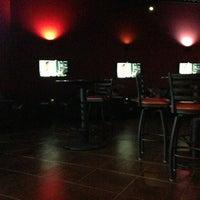 Photo taken at Oasis Hookah Lounge by Krissy K. on 7/13/2013
