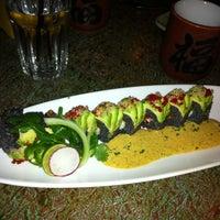 Photo taken at Musashino Sushi Dokoro by Jamie R. on 12/17/2012
