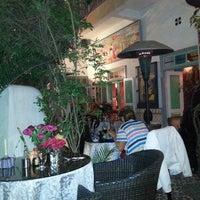 Photo taken at Caravane café by Dick E. on 5/15/2014