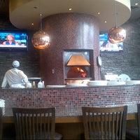 Photo taken at Enoteca Mozza - Pizzeria Moderna by Andrea I. on 3/14/2013