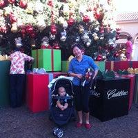 Photo taken at Fashion Island Gigantic Christmas Tree by CJ Y. on 12/24/2013