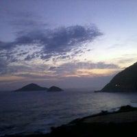 Photo taken at Praia de Grumari by Jenifer S. on 1/6/2013