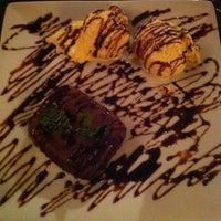 Photo taken at Delluccio Pizza Bar by Papola M. on 5/18/2013