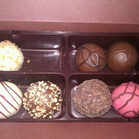Photo taken at Godiva Chocolatier by Daniel P. on 3/4/2012