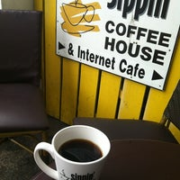Photo taken at Sippin' Internet Cafe by Mike M. on 1/5/2013