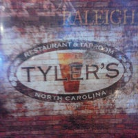 Photo taken at Tyler's Restaurant & Taproom by James K. on 4/12/2013